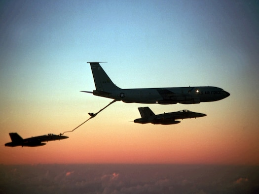 A KC-135 Stratotanker refuels an F-15 Eagle midflight. The Stratotanker was originally used to support bombers of the Strategic Air Command. The midair refueling capabilities allowed fighter missions to spend hours on the front lines, rather than a few minutes, which was usually due to the limited size of fuel tanks in the fighters. (Courtesy Photo)