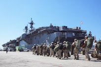 Marines with Task Force Los Angeles prepare to board the USS America at Naval Base San Diego, Calif., Aug. 29, 2016. The ship will carry Marines, sailors, and Coast Guardsmen to Fleet Week in Los Angeles, Sept. 2 -- Sept. 5.  Marine Corps photo by Lance Cpl. Caitlin Bevel