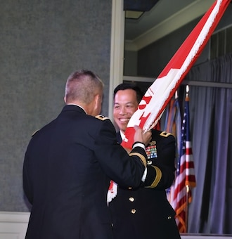 Brig. Gen. Mark Toy, incoming LRD Commander, accepts the USACE flag from Lt. Gen. Todd Semonite, Chief of Engineers and USACE Commanding General, during a change of command ceremony in Cincinnati on August 31, 2016.