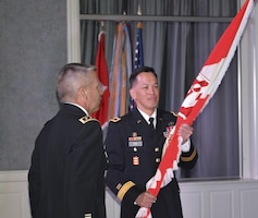 Brig. Gen. Mark Toy holds the USACE flag during the LRD Change of Command Ceremony in Cincinnati on August 31, 2016.