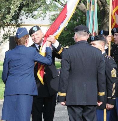 Lt. Gen. Jeffrey S. Buchanan (second from left) receives the colors from Gen. Lori J. Robinson (left), commander, North American Aerospace Defense Command and U.S. Northern Command to assume command of U.S. Army North and the senior mission commander of Fort Sam Houston and Camp Bullis from Lt. Gen. Perry L. Wiggins (third from left) during the U.S. Army North change of command ceremony at the Fort Sam Houston Quadrangle Friday.