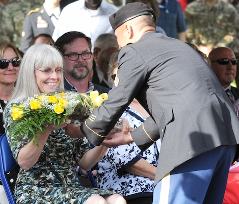Laura Buchanan, wife of Lt. Gen. Jeffrey S. Buchanan, receives roses from a U.S. Army North Soldier to welcome her to the ARNORTH family during the ARNORTH change of command ceremony at the Fort Sam Houston Quadrangle Friday.