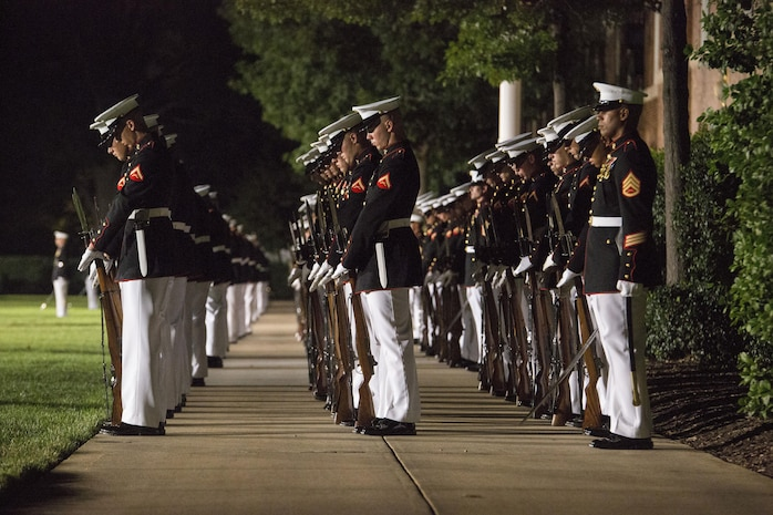 """Marines of Marine Barracks Washington, D.C., execute the command """"fix bayonets"""" during the Evening Parade at Marine Barracks Washington, D.C., Aug. 26, 2016. The guest of honor for the parade was the Honorable Ashton B. Carter, Secretary of Defense, and the hosting official was Gen. Robert B. Neller, commandant of the Marine Corps. (Official Marine Corps photo by Cpl. Andrianna Daly/Released)"""