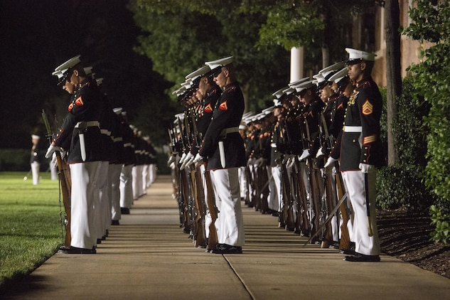 "Marines of Marine Barracks Washington, D.C., execute the command ""fix bayonets"" during the Evening Parade at Marine Barracks Washington, D.C., Aug. 26, 2016. The guest of honor for the parade was the Honorable Ashton B. Carter, Secretary of Defense, and the hosting official was Gen. Robert B. Neller, commandant of the Marine Corps. (Official Marine Corps photo by Cpl. Andrianna Daly/Released)"