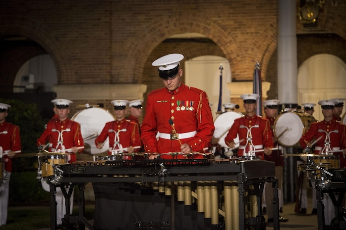 The United States Marine Drum and Bugle Corps performs during the Evening Parade at Marine Barracks Washington, D.C., Aug. 26, 2016. The guest of honor for the parade was the Honorable Ashton B. Carter, Secretary of Defense, and the hosting official was Gen. Robert B. Neller, commandant of the Marine Corps. (Official Marine Corps photo by Cpl. Andrianna Daly/Released)
