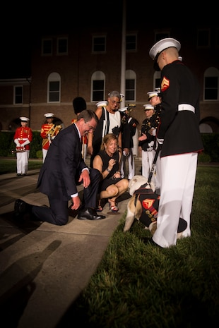 The Honorable Ashton B. Carter, Secretary of Defense and his wife, Stephanie Carter, greet the official Marine Corps mascot, Cpl. Chesty XIV, at the end of the evening parade at Marine Barracks Washington Aug. 26, 2016. The guest of honor for the parade was the Honorable Ashton B. Carter, Secretary of Defense, and the hosting official was Gen. Robert B. Neller, commandant of the Marine Corps. (Official Marine Corps photo by Cpl. Andrianna Daly/Released)