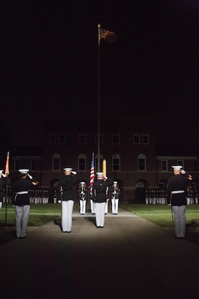 The United States Marine Corps Color Guard performs during the Evening Parade at Marine Barracks Washington, D.C., Aug. 26, 2016. The guest of honor for the parade was the Honorable Ashton B. Carter, Secretary of Defense, and the hosting official was Gen. Robert B. Neller, commandant of the Marine Corps. (Official Marine Corps photo by Lance Cpl. Robert Knapp/Released)
