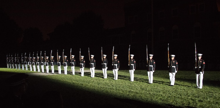 The United States Marine Corps Silent Drill Platoon performs during the Evening Parade at Marine Barracks Washington, D.C., Aug. 26, 2016. The guest of honor for the parade was the Honorable Ashton B. Carter, Secretary of Defense, and the hosting official was Gen. Robert B. Neller, commandant of the Marine Corps. (Official Marine Corps photo by Lance Cpl. Robert Knapp/Released)