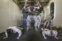 Marines do burpees, which work the entire body, during a physical fitness and weapons knowledge test on the USS San Antonio in the Gulf of Aden, Aug. 30, 2016. The Marines, assigned to the 22nd Marine Expeditionary Unit, are maintaining regional security in the U.S. 5th Fleet area of operations. Marine Corps photo by Sgt. Ryan Young