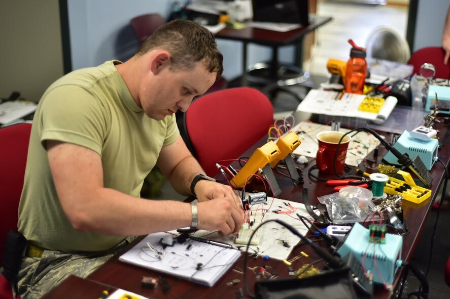 Tech. Sgt. Aaron Clark, EOD team leader, 914th Airlift Wing Civil Engineer Squadron, creates components for a fake improvised explosive device during training on base, August 11, 2016. The exercise was held to teach members how to identify and dismantle IEDs. (U.S. Air Force photo by Staff Sgt. Richard Mekkri/released)