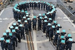 Sailors aboard the guided-missile cruiser USS Chancellorsville form a teal ribbon in recognition of  Sexual Assault Awareness and Prevention  Month, April 27, 2016. The teal ribbon signifies the Navy's zero tolerance policy against sexual assault. Navy photo by Fire Controlman 2nd Class Monica Strickler