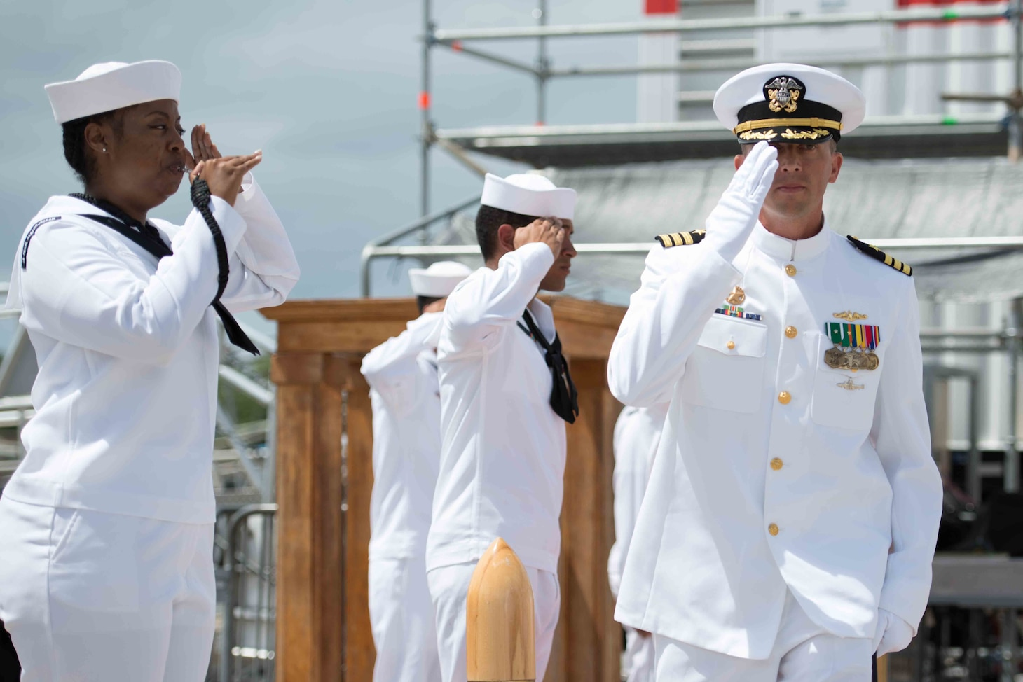 160830-N-LY160-198 JOINT BASE PEARL HARBOR-HICKAM, Hawaii (August 30, 2016) Cmdr. Chad Hardt, commanding officer of the Los Angeles-class fast-attack submarine USS Tucson (SSN 770), is piped ashore at the conclusion of the change of command ceremony in Joint Base Pearl Harbor-Hickam. Hardt relieves Cmdr. Michael Beckette as the 10th commanding officer of the USS Tucson. (U.S. Navy photo by Mass Communication Specialist 2nd Class Michael H. Lee)