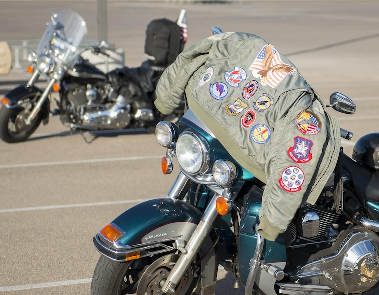 A jacket draped over a motorcycle bears patches from numerous Air Force squadrons Aug. 26, 2016 at Holloman Air Force Base, N.M. The 49th Wing Safety office hosts a ride every year to promote safe habits and improve riders' skills. (U.S. Air Force photo by Airman 1st Class Randahl J. Jenson)