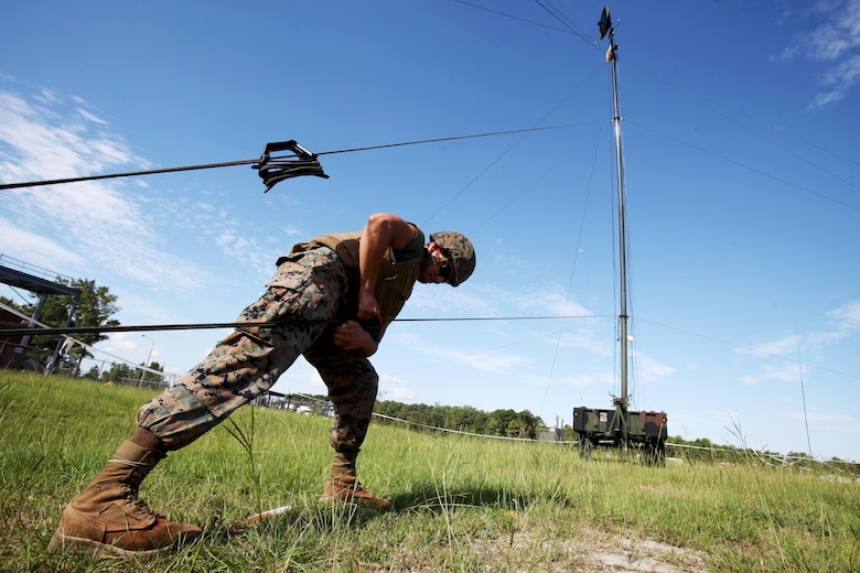 Lance Cpl. Hector Coronado tightens the stabilizing line to a Tactical Elevated Antenna Mast System during a field exercise conducted by Alpha Company, Marine Wing Communications Squadron 28, aboard Marine Corps Air Station Cherry Point, N.C., Aug. 23, 2016. The two-week exercise occurs annually to satisfy training and readiness requirements and serve as an opportunity for Marines to reaffirm previously learned skillsets. Coronado is a field radio operator with MWCS-28(U.S. Marine Corps photo by Cpl. Jason Jimenez/Released)