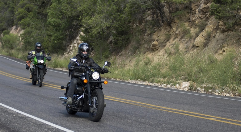 Riders participating in Holloman's 2016 Motorcycle Ride drive through High Rolls, N.M., Aug. 26, 2016. Nearly 40 riders participated in the 100-mile ride stretching from Holloman Air Force Base to Ruidoso and back. (U.S. Air Force photo by Airman 1st Class Randahl J. Jenson)