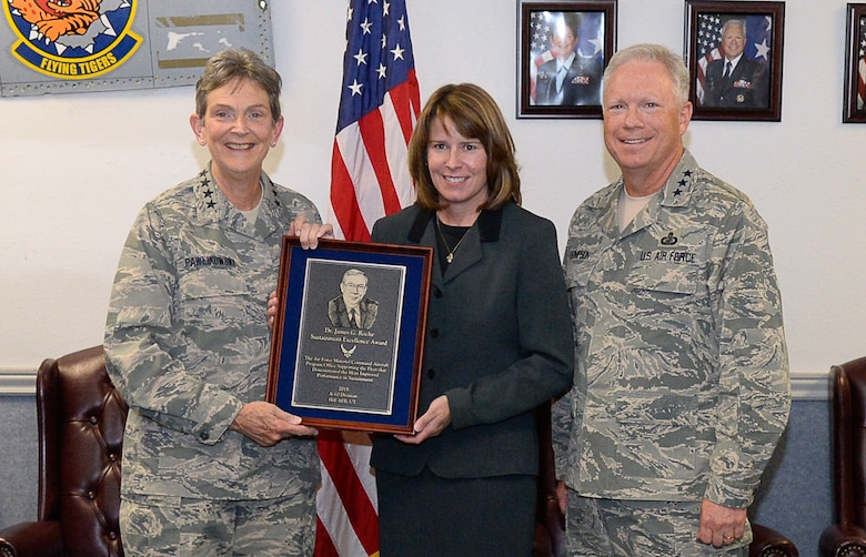 Gen. Ellen Pawlikowski, Air Force Materiel Command commander, presents the 2015 Dr. James G. Roche Sustainment Excellence Award to Dawn Sutton, A-10 System Program Office team leader, Aug. 31 during a meeting of AFMC leaders at Hill AFB.  Also pictured is Lt. Gen. John Thompson, Air Force Life Cycle Management Center commander. The award is presented annually based upon objective criteria to the AFMC program office with the most improved performance in fleet sustainment during the given fiscal year.  (U.S. Air Force photo by Todd Cromar)