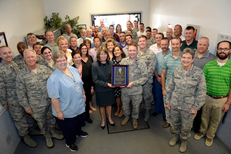 The A-10 System Program Office team receives the 2015 Dr. James G. Roche Sustainment Excellence Award Aug. 31 during a meeting of AFMC leaders at Hill AFB. The award is presented annually based upon objective criteria to the AFMC program office with the most improved performance in fleet sustainment during the given fiscal year, and is named after Dr. James Roche, a former U.S. Navy officer and the 20th Secretary of the Air Force. (U.S. Air Force photo by Todd Cromar)