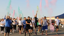 Members of Team March start the third annual color run in traditional fashion, here at March Air Reserve Base California.