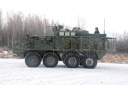 """Boasting an upgraded chassis and drivetrain along with a variety of mechanical, electrical and digital improvements to enhance its performance, a new variant of the Stryker Combat Vehicle underwent a winter of extreme use at U.S. Army Cold Regions Test Center earlier this year. """"It looks like a regular Stryker, but it isn't,"""" said Richard Reiser, test officer. """"It has a larger engine that significantly increases horsepower and torque."""""""