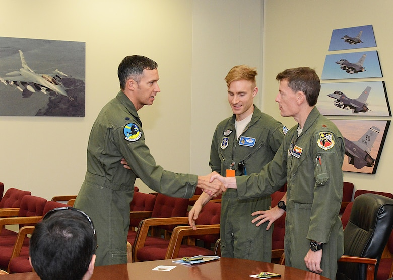 From left: Lt. Col. Chris Keithley, 416th Flight Test Squadron commander, thanks F-16 pilot trainee Ocho and Maj. Luke O'Sullivan, 152nd Fighter Squadron, Arizona Air National Guard, for visiting the 416th FLTS Aug. 25. (U.S. Air Force photo by Kenji Thuloweit)
