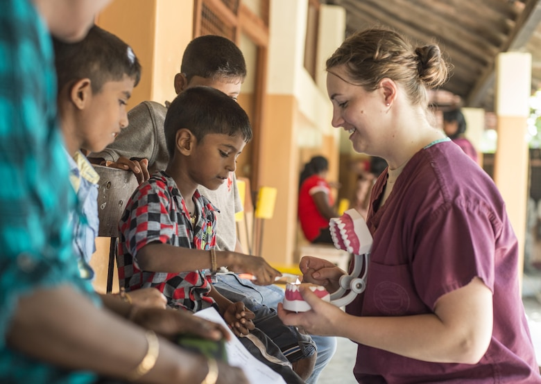 U.S. Air Force Senior Airman Makensy Lefler, 354th Dental Squadron dental technician, teaches local children how to properly brush their teeth during Pacific Angel 16-3 (PACANGEL) in Jaffna, Sri Lanka, Aug. 20, 2016. PACANGEL is a total force, joint and combined humanitarian assistance/civil military operation led by U.S. Pacific Air Forces. Assistance during PACANGEL included general health, dental, optometry and physical therapy. (U.S. Air Force photo by Senior Airman Brittany A. Chase)