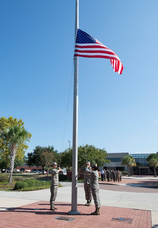 Team Charleston Airmen raise the American flag during a retreat ceremony recognizing Women's Equality Day at Joint Base Charleston, South Carolina, Aug. 26, 2016. The day commemorates the passage of the 19th Amendment but also highlights the barriers women have overcome in their progress toward equality. (U.S. Air Force photo by Staff Sgt. Andrea Salazar/Released)