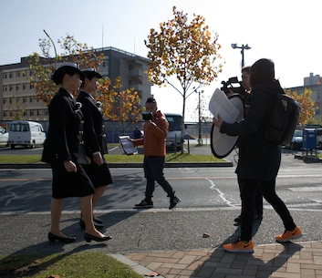 The Hakuhodo film team records a promotion video at Marine Corps Air Station Iwakuni, Japan, Nov. 29, 2016. Hakuhodo Inc. teamed up with the Japan Maritime Self-Defense Force to create a promotion video to show how the JMSDF is active in the community. (U.S. Marine Corps photo by Pfc. Gabriela Garcia-Herrera)