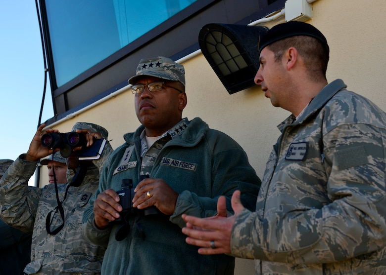 Master Sgt. William Hinchcliff, 31st Security Forces flight chief, talks to Lt. Gen. Richard Clark, 3rd Air Force commander, during a security forces demonstration at Aviano Air Base, Italy on Nov. 30, 2016. Clark toured the base, met with Airmen and hosted an all call to thank Team Aviano for their hard work and dedication to the mission. (U.S. Air Force photo by Senior Airman Cary Smith)