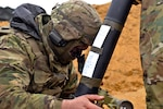 Army Pfc. Matthew Guizer sights an 81 mm M252 mortar system during live-fire training at Wedrzyn, Poland, Nov. 30, 2016. Guizer is an indirect fire infantryman assigned to Headquarters Company, 2nd Battalion, 503rd Infantry Regiment, 173rd Airborne Brigade -- a unit regularly stationed in Germany. This was the final training exercise for the unit in Poland and its continued support of Operation Atlantic Resolve with NATO Allies. Army photo by Sgt. William A. Tanner