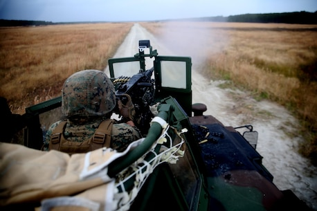 Private first class Alex Pelletier fires a .50 Cal. machine gun during a live-fire training exercise at Marine Corps Base Camp Lejeune, N.C., Nov. 29, 2016. Marines with Combined Anti-Armor team, Weapons Company, 2nd Battalion, 2nd Marine practiced vehicle buddy rushes with High Mobility Multipurpose Wheeled Vehicles to improve communication and movement through an objective. Pelletier is a machine gunner with the unit.