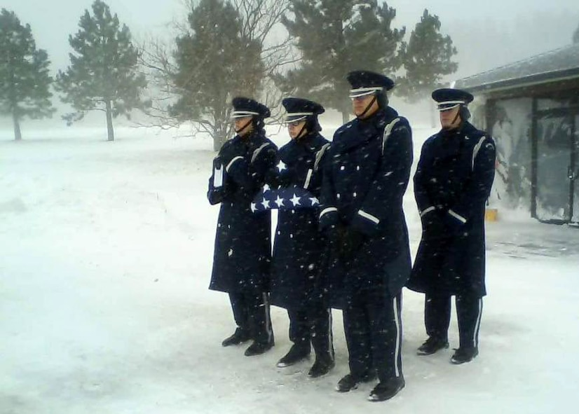 Airmen from the Ellsworth Air Force Base Honor Guard conduct a burial ceremony for a veteran during a winter storm at the Black Hills National Cemetery in Sturgis, S.D., Nov. 29, 2016. The primary mission of the honor guard is to provide full military funeral honors to our veterans, retirees and active-duty personnel. In total, seven Airmen were required at the cemetery to properly conduct the full retiree ceremony, which is as a solemn act of recognition and remembrance by a grateful nation for dedicated service and sacrifices. (Courtesy photo)
