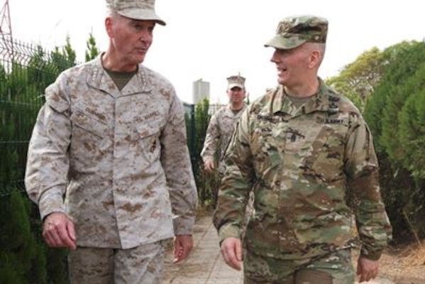 Gen. Joseph F. Dunford, chairman of the Joint Chiefs of Staff, left, and Command Sgt. Maj. John W. Troxell, senior enlisted advisor to the chairman, meet with troops in Erbil, Iraq, Nov. 10, 2016. (DoD photo by D. Myles Cullen)