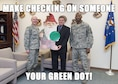 From left: Brig. Gen. Carl Schaefer, 412th Test Wing commander; Marlan Woodside, Green Dot implementer; and Chief Master Sgt. Todd Simmons, 412th TW command chief; pose with Gunijoglas, a gnome that will appear in different locations from Dec. 5-9. People who find Gunijoglas can take a selfie and create a meme to post to the Edwards afb Green Dot Facebook page. (U.S. Air Force image by Ethan Wagner and Kenji Thuloweit)