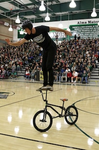 BMX rider Trevor Meyer performs a stunt at Monrovia High School in Monrovia, Calif., during the Action Sports Association Entertainment high-school tour with the U.S. Marines from Recruiting Sub Station Pasadena, Nov. 29, 2016. The ASA High School Tour is a high-energy action sports circuit that visits cities across the United States supporting the Anti-Defamation League's No Place for Hate campaign and the campaign for Tobacco-Free Kids.  ASA brings in five of the world's top professional skateboarders, inline skaters and BMX riders from the X Games to perform on a state-of-the-art half-pipe, while an emcee delivers an educational message in a fun, positive and interactive fashion.  Students can win prizes, get autographs and participate in a variety of contests with our partners. (U.S. Marine Corps photo by Staff Sgt. Alicia R. Leaders/Released)