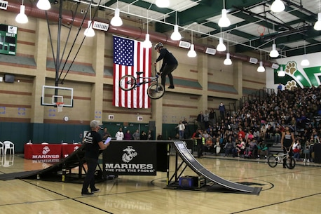 BMX rider Anthony Napolitan performs a stunt at Monrovia High School in Monrovia, Calif., during the Action Sports Association Entertainment high-school tour with the U.S. Marines from Recruiting Sub Station Pasadena, Nov. 29, 2016. The ASA High School Tour is a high-energy action sports circuit that visits cities across the United States supporting the Anti-Defamation League's No Place for Hate campaign and the campaign for Tobacco-Free Kids.  ASA brings in five of the world's top professional skateboarders, inline skaters and BMX riders from the X Games to perform on a state-of-the-art half-pipe, while an emcee delivers an educational message in a fun, positive and interactive fashion.  Students can win prizes, get autographs and participate in a variety of contests with our partners. (U.S. Marine Corps photo by Staff Sgt. Alicia R. Leaders/Released)