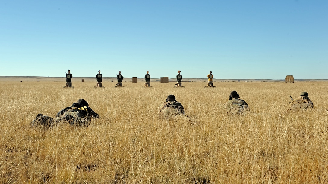 Members of the 27th Special Operations Civil Engineer Squadron Explosive Ordnance Disposal flight zero their weapons prior to conducting live fire training utilizing state-of-the-art Robotic Human Type Targets, Nov. 8, 2016, at Melrose Air Force Range, N.M. RHTT targets are autonomous and smart in nature, allowing for the creation of infinite realistic scenarios which call for Air Commandos to employ elevated tactical thought processes, and execute appropriate courses of action with real-time urgency. (U.S. Air Force photo by Staff Sgt. Whitney Amstutz/Released)