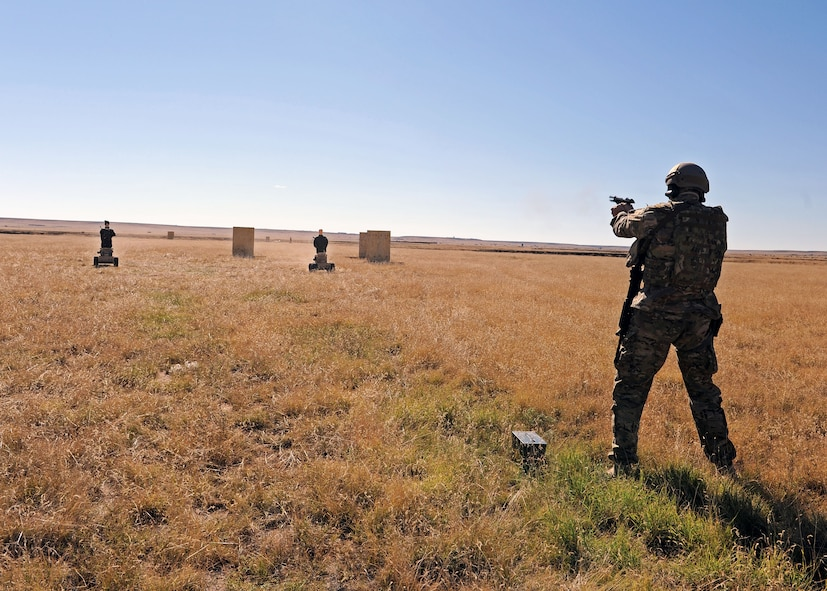 A member of the 27th Special Operations Civil Engineer Squadron Explosive Ordnance Disposal flight fires an M9 at two Robotic Human Type Targets as they approach during live fire training Nov. 8, 2016, at Melrose Air Force Range, N.M. RHTT targets are autonomous and smart in nature, allowing for the creation of infinite realistic scenarios which call for Air Commandos to employ elevated tactical thought processes, and execute appropriate courses of action with real-time urgency. (U.S. Air Force photo by Staff Sgt. Whitney Amstutz/Released)