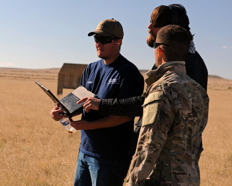 A member of the 27th Special Operations Civil Engineer Squadron Explosive Ordnance Disposal flight discusses training scenarios with members of the Robotic Human Type Targets team during live fire training Nov. 8, 2016, at Melrose Air Force Range, N.M. RHTT targets are autonomous and smart in nature, allowing for the creation of infinite realistic scenarios which call for Air Commandos to employ elevated tactical thought processes, and execute appropriate courses of action with real-time urgency. (U.S. Air Force photo by Staff Sgt. Whitney Amstutz/Released)