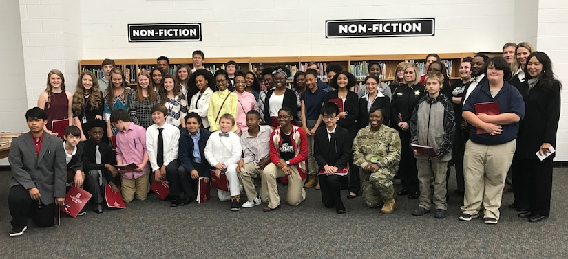 Furman Middle School students stand with Sumter community business leaders during career day Nov 16, 2016, at Furman Middle School. Six business, including U.S. Army Central, conducted round table discussions with students as part of the Sumter School District and Chamber of Commerce student career forum prior taking business tours Nov. 30, 2016.