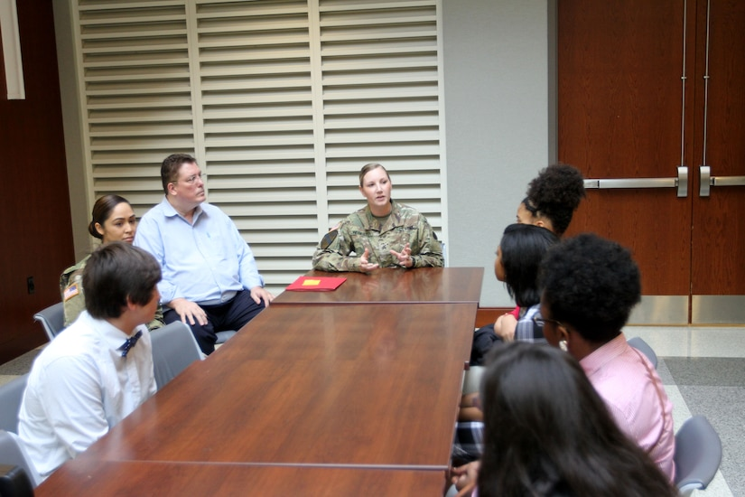 U.S. Army Central noncommissioned officer Sgt. Leslie Regester (center), explains her job as an Army medic during career day for Furman Middle School students Nov. 30, 2016, at Shaw Air Force Base, S.C. Students learned about the many ways to serve in the military during a tour of USARCENT's Patton Hall