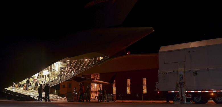 Members from Lockheed Martin prepare the loading ramp of a C-17 Globemaster III Nov. 30, 2016, at Buckley Air Force Base, Colo. Members from Lockheed Martin worked with an aircrew from the 729th Airlift Squadron to load a GPS non-flight satellite testbed prior to flying to Cape Canaveral, Florida. The GPS non-flight satellite testbed is a pathfinder vehicle used by the Space and Missile Systems Center to ensure future GPS III vehicles are adequately tested. (U.S. Air Force photo by Airman Holden S. Faul/ Released)