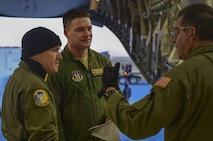From left to right: Tech. Sgt. Andrew Chavez, 729th Airlift Squadron loadmaster, Senior Airman Gabe Day, 729th Airlift Squadron loadmaster, and Chief Master Sgt. Frank Gamache, 452nd Airlift Control Flight loadmaster, strategize how to safely load a C-17 Globemaster III Nov. 30, 2016, at Buckley Air Force Base, Colo. Members from Lockheed Martin worked with an aircrew from the 729th Airlift Squadron to load a GPS non-flight satellite testbed prior to flying to Cape Canaveral, Florida. The GPS non-flight satellite testbed is a pathfinder vehicle used by the Space and Missile Systems Center to ensure future GPS III vehicles are adequately tested. (U.S. Air Force photo by Airman Holden S. Faul/ Released)