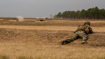 A Marine with 1st Battalion, 8th Marine Regiment. engages a target during a fire and maneuver range at Camp Lejeune, N.C., Nov. 29, 2016. The range was held in order to sharpen the fundamentals of the Marines and increase combat readiness.
