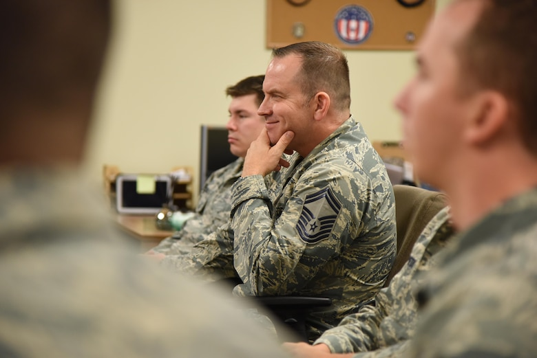Senior Master Sgt. Marc Gibson, 81st Training Support Squadron Military Training Leader Course student, listens to Col. Michele Edmondson, 81st Training Wing commander, deliver welcoming remarks to MTL Course students at Allee Hall Nov. 29, 2016, on Keesler Air Force Base, Miss. This is the second class to attend the schoolhouse's new four-week course curriculum, which was upped from two weeks and boasts a higher level of hands-on, practical application than its previous format. (U.S. Air Force photo by Kemberly Groue)