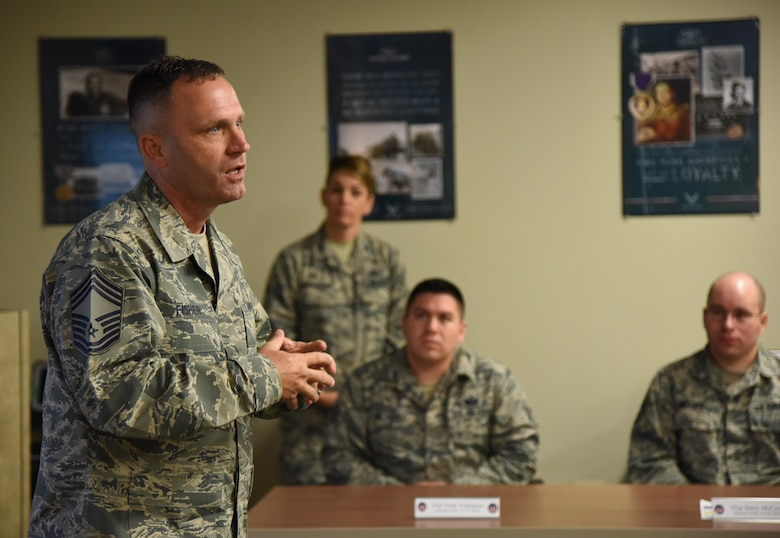Chief Master Sgt. Anthony Fisher, 81st Training Group superintendent, delivers welcoming remarks to 81st Training Support Squadron Military Training Leader Course students at Allee Hall Nov. 29, 2016, on Keesler Air Force Base, Miss. This is the second class to attend the schoolhouse's new four-week course curriculum, which was upped from two weeks and boasts a higher level of hands-on, practical application than its previous format. (U.S. Air Force photo by Kemberly Groue)