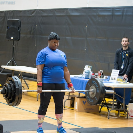 Tech. Sgt. Natasha Fenton executes a clean dead lift at the Joint Base Myer-Henderson Hall Inaugural Powerlifting Meet Oct. 29, 2016. (Courtesy photo)