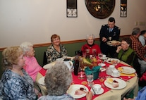 Major Carlos DeDios, 5th Bomb Wing deputy judge advocate, serves food during the annual Day of Love at Minot Air Force Base, Nov. 24, 2016. During the event, Minot senior citizens are invited on base for a Thanksgiving meal served by military members. (U.S. Air Force photo/Airman 1st Class Christian Sullivan)