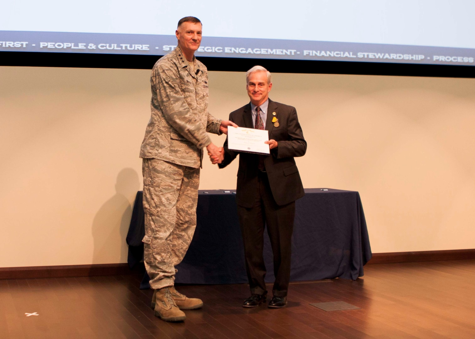 Perry Knight, chief of staff at Defense Logistics Agency Distribution, receives the Secretary of Defense Medal for Meritorious Civilian Service during DLA Director Air Force Lt. Gen. Andy Busch's inaugural town hall at the new Distribution headquarters building on Nov. 18.