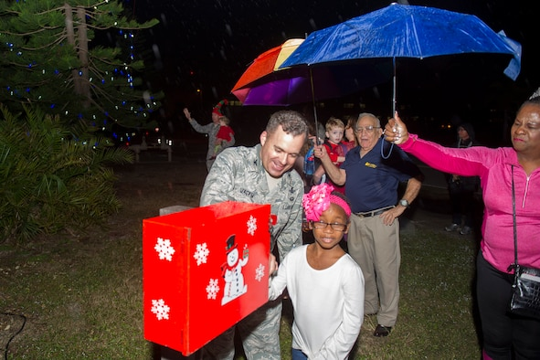 Col. Z. Walter Jackim, 45th Space Wing vice commander, assists with turning on the switch during the Christmas Tree Lighting Ceremony Nov. 30, 2016, at the Seaside Chapel at Patrick Air Force Base, Fla. In addition to the ceremony, patrons sang carols, had refreshments and socialized. (U.S. Air Force photo/Phil Sunkel)