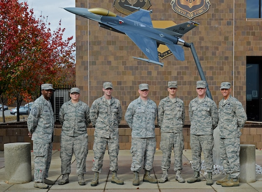 U.S. Airmen assigned to the 20th Operations Support Squadron aircrew flight equipment team are recognized by Col. Daniel Lasica, 20th Fighter Wing commander, left, and Chief Master Sgt. Christopher McKinney, 20th FW command chief, right, during an Airman Up! presentation at Shaw Air Force Base, S.C., Nov. 30, 2016. The Airmen were recognized for demonstrating perseverance, resiliency and dedication to excellence during a unit effectiveness inspection earlier this year. (U.S. Air Force photo by Airman 1st Class BrieAnna Stillman)